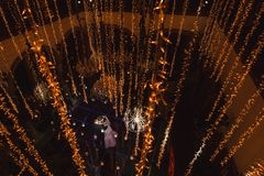 Newlywed couple dancing first dance from above, bride and groom waltz dancefloor lowlight. Newlywed couple dancing at their wedding reception over mirror dance royalty free stock photography