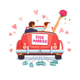 Newlywed couple is driving car for their honeymoon Stock Photos