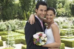 Newlywed Couple Embracing Stock Photography