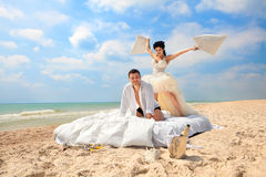 Newlywed couple fighting with pillows Royalty Free Stock Photo
