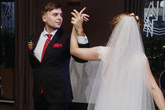 Newlywed couple first dance at ballroom, bride and groom dancing. At wedding reception in restaurant, happy handsome husband and beautiful wife moment Royalty Free Stock Image