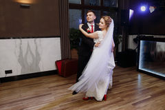 Newlywed couple first dance at ballroom, bride and groom dancing. At wedding reception in restaurant, happy handsome husband and beautiful wife moment Stock Images