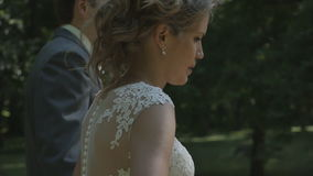 A newlywed couple go to the Park and talk. The bride and groom on a walk, the Park, Steadicam, camera movement stock video