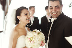 Newlywed couple happy husband and beautiful brde under wedding a. Rbor Royalty Free Stock Photography