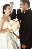 Newlywed couple happy husband and beautiful brde under wedding a. Rbor Stock Photography