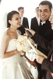 Newlywed couple happy husband and beautiful brde under wedding a. Rbor Royalty Free Stock Photos