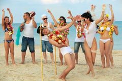 Newlywed Couple Have Fun Doing The Limbo Stock Images