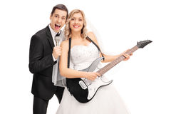 Newlywed couple having fun and playing music Stock Photos