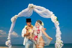 Newlywed couple in Hawaiian Hula Stock Images