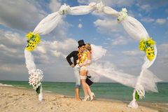 Newlywed couple in Hawaiian Hula Stock Photography