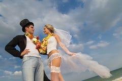 Newlywed couple in Hawaiian Hula Stock Images