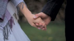 Newlywed couple holding hands stock video