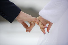 Newlywed couple holding hands stock images