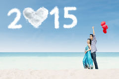 Newlywed couple honeymoon in new year Stock Photos