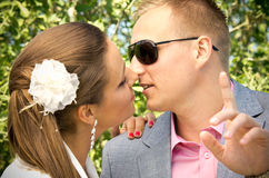 Newlywed couple kissing Stock Image