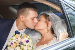 Newlywed Couple Kissing Each Other In car Royalty Free Stock Photos