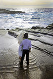 Newlywed couple on lava cliffs Royalty Free Stock Photo