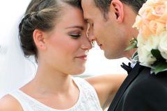 A newlywed couple look happy. And really loving each other Royalty Free Stock Images