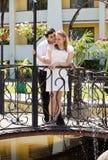 Newlywed couple in love stood on bridge Stock Photos