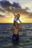 Newlywed couple in the ocean Royalty Free Stock Photo