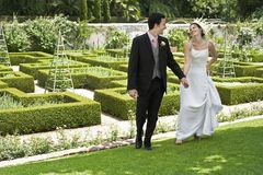 Newlywed Couple In Park Stock Photo