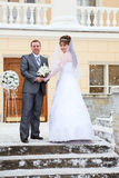Newlywed couple on porch in winter Royalty Free Stock Photos