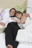 Newlywed Couple Relaxing In Bed Royalty Free Stock Photos