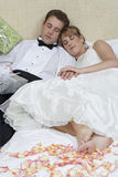 Newlywed Couple Relaxing In Bed Stock Photography