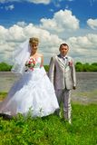 Newlywed couple by river Stock Photo