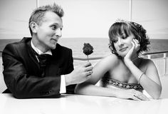 Newlywed couple with rose Stock Photography