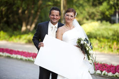 Newlywed couple with sign Stock Photos
