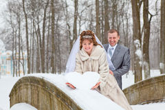 Newlywed couple standing on the bridge Royalty Free Stock Image