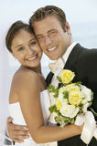 Newlywed Couple Standing Cheek To Cheek Royalty Free Stock Photos