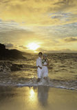 Newlywed couple at sunrise Stock Photography