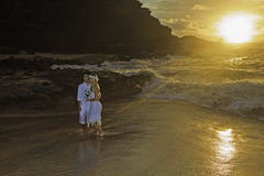 Newlywed couple at sunrise Royalty Free Stock Photo