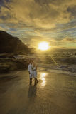 Newlywed couple at sunrise Stock Photos