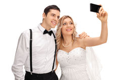 Newlywed couple taking a selfie with phone Stock Photo