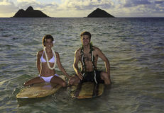 Newlywed couple on their surfboards Royalty Free Stock Images