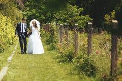 Newlywed couple together. Bonds of matrimony. Newlywed couple together. Young groom and bride Stock Photos