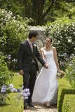 Newlywed Couple Walking In The Park Stock Image