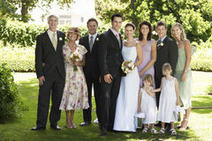 Newlywed Couple With Wedding Guests In Garden Royalty Free Stock Images