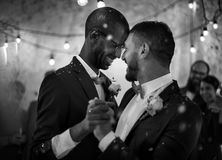 Newlywed Gay Couple Dancing on Wedding Celebration royalty free stock images