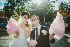 Newlywed happy couple walking in the amusement Stock Photos