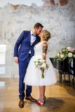 Newlywed couple kiss right after the ceremony royalty free stock photos
