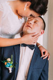 Newlywed pair have a sweet intimate moment after wedding ceremony Royalty Free Stock Images