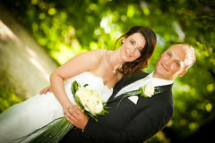 Newlywed portrait of couple with bouquet Stock Images