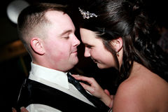 Newlywed's First Dance. A young bride and groom share their first dance at their wedding reception Stock Photos