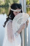 Newlywed woman poses with her ​​fan Stock Photography