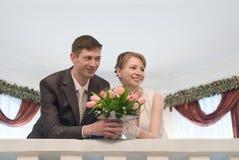 Newlywed young couple on balcony Stock Photos