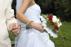 Newlyweds. In handcuffs, without faces Royalty Free Stock Image